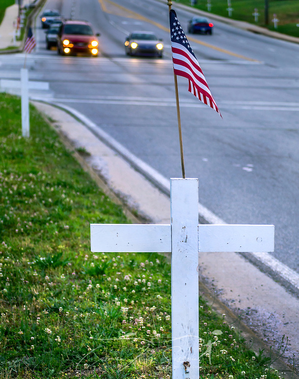 White crosses line New Peachtree Road in Doraville, Georgia, May 29, 2014. The crosses bear the names of the town's fallen war veterans. (Photo by Carmen K. Sisson/Cloudybright)