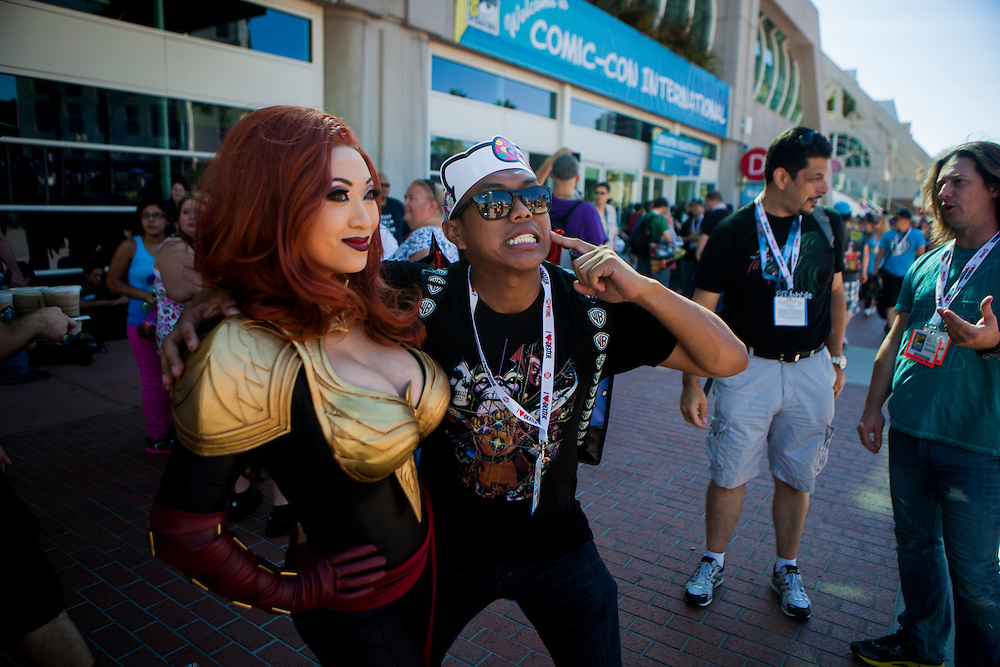 Cosplayer Yaya Han heads out poses for fans at Comic Con portraying Phoenix from Marvel Avengers Alliance.