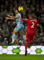 03.01.2012, Etihad Stadion, Manchester, ENG, PL, Manchester City vs FC Liverpool, 19. Spieltag, im Bild Liverpool's Glen Johnson in action against Manchester City's Sergio Aguero // during the football match of English premier league, 19th round, between Manchester City and FC Liverpool at Etihad Stadium, Manchester, United Kingdom on 2012/01/03. EXPA Pictures © 2012, PhotoCredit: EXPA/ Propagandaphoto/ David Rawcliff..***** ATTENTION - OUT OF ENG, GBR, UK *****