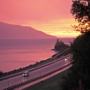 Sunset and clearing storm, Turnagain Arm of Cook Inlet with Seward Highway, near Bird Creek, Alaska