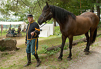 Bob Beausoleil leads a Canadian horse through the campsite of the Civil War encampment staged at the NH Veterans Association compound at Lakeside Avenue in the Weirs Sunday morning.   (Karen Bobotas/for the Laconia Daily Sun)
