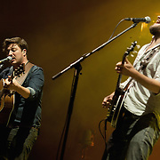 KANSAS CITY, KS - SEPTEMBER 20:  Lead singer Marcus Mumford and banjo player Winston Marshall performing with Mumford & Sons at the Cricket Wireless Amphitheater on September 20, 2013 in Kansas City, Kansas.  (Photo by Fernando Leon/Getty Images) *** Local Caption *** Marcus Mumford;Winston Marshall