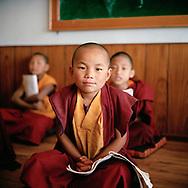 Attending class in primary school - Tsoknyi Gechak Ling nunnery, Nepal, 2014