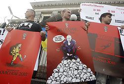 June 14, 2018 - Kiev, Ukraine - Ukrainian activists hold posters by artist Andrii Yermolenko during their protest demanding the boycott of the FIFA World Cup 2018 and the release of political prisoners held in Russia, in front of the Embassy of Russia in Kiev, Ukraine, on 14 June,2018. (Credit Image: © Serg Glovny via ZUMA Wire)