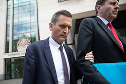 © Licensed to London News Pictures. 22/07/2019. London, UK. Chris Holmes - Baron Holmes of Richmond (left) leaves Westminster Magistrates' Court where he appeared on charges of sexual assault. Photo credit : Tom Nicholson/LNP