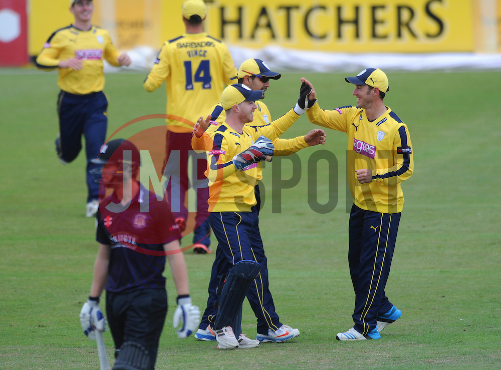 Adam Wheater of Hampshire celebrates with team mates after running out Ian Cockbain of Gloucestershire  - Photo mandatory by-line: Dougie Allward/JMP - Mobile: 07966 386802 - 14/07/2015 - SPORT - Cricket - Cheltenham - Cheltenham College - Natwest T20 Blast