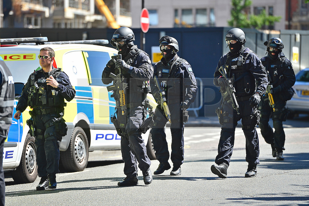 © Licensed to London News Pictures. 30/06/2015. London, UK. Armed police at the scene. Members of the emergency service take part in a mocked-up terrorist firearms attack at Aldwych station in central London. The exercise is the biggest to take place in London and is happening a week after dozens of people where killed when a gunman opened fire on a beach in Tunisia.  Photo credit: Ben Cawthra/LNP