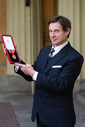 Baritone Sir Simon Keenlyside Poses with his Knights Bachelor medal after being knighted at an investiture by HRH The Prince of Wales at Buckingham Palace in London. London, February 07 2019.