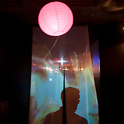November 16, 2012 - New York, NY : Backlit by a digital video projection, a man is silhouetted as he enters the event space for the Oorutaichi concert at the Japan Society in Manhattan on Friday night.    CREDIT: Karsten Moran for The New York Times CREDIT: Karsten Moran for The New York Times