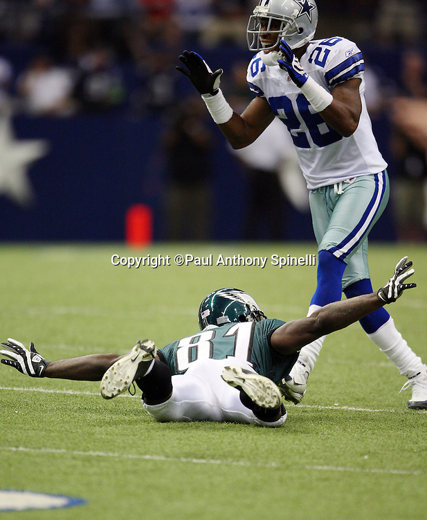 IRVING, TX - SEPTEMBER 15:  Wide receiver Jason Avant #81 of the Philadelphia Eagles spreads his arms as he hits the ground while covered on a pass play by safety Ken Hamlin #26 of the Dallas Cowboys at Texas Stadium on September 15, 2008 in Irving, Texas. The Cowboys defeated the Eagles 41-37. ©Paul Anthony Spinelli *** Local Caption *** Jason Avant;Ken Hamlin