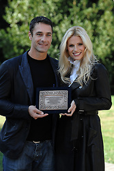"11.11.2011, Casa del Cinema, Villa Borghese, ITA, Fototermin bei den Dreharbeiten für den Kurzfilm Amore Nero, der Film erzählt von der Gewalt gegen Frauen und Stalking, im Bild Raul BOVA and Michelle HUNZIKER attend the photocall of the short film ""Amore Nero"" with a plaque of Italian Republic President Giorgio Napolitano, ""Amore Nero"" talks about violence against women and stalking. Casa del Cinema, Villa Borghese, Italy on 11/11/2011. EXPA Pictures © 2011, PhotoCredit: EXPA/ Insidefoto/ Andrea Staccioli..***** ATTENTION - for AUT, SLO, CRO, SRB, SUI and SWE only *****"