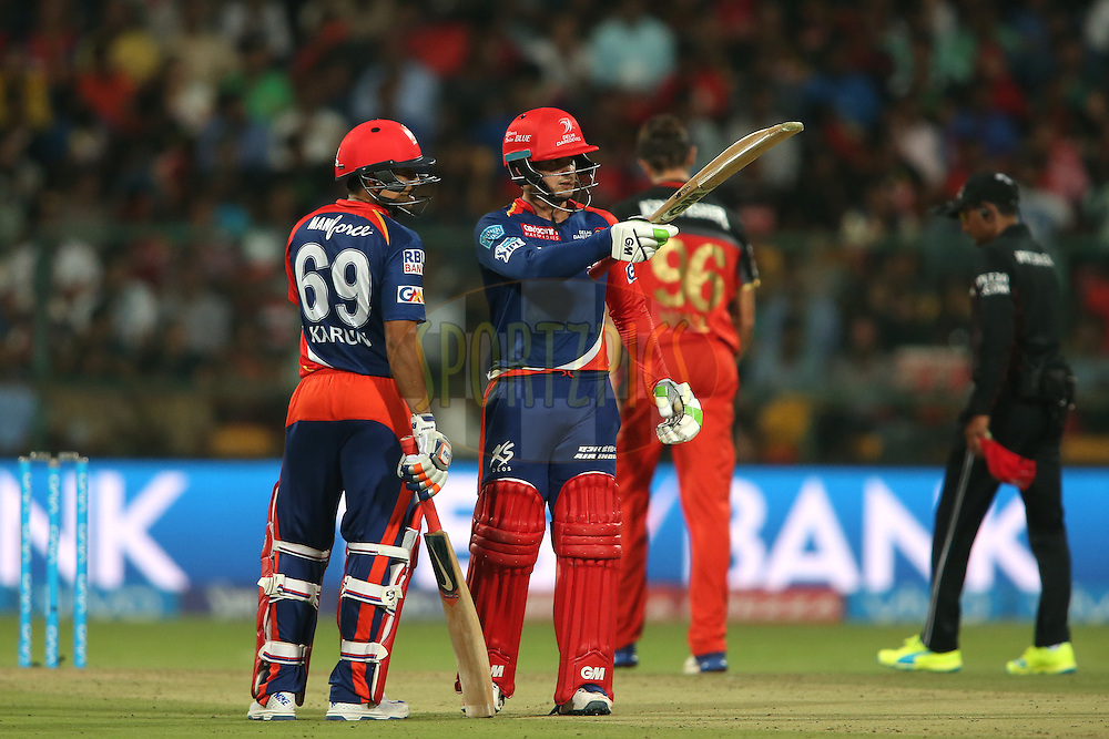 Quinton de Kock of Delhi Daredevils raises his bat after reaching his fifty during match 11 of the Vivo IPL (Indian Premier League) 2016 between the Royal Challengers Bangalore and the Delhi Daredevils held at The M. Chinnaswamy Stadium in Bangalore, India,  on the 17th April 2016<br /> <br /> Photo by Shaun Roy / IPL/ SPORTZPICS