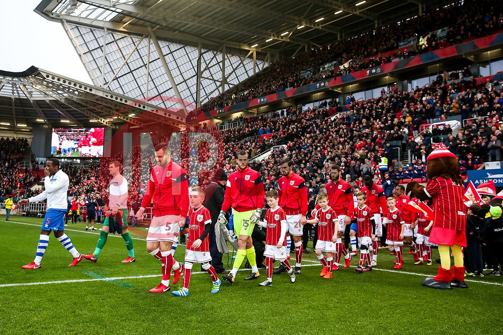 Nedum Onuoha of Queens Park Rangers and Bailey Wright of Bristol City lead the way as the teams come out of the tunnel for the start of the match - Rogan/JMP - 27/01/2018 - Ashton Gate Stadium - Bristol, England - Bristol City v Queens Park Rangers - Sky Bet Championship.