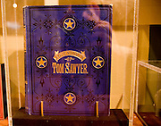 "USA Missouri MO, Hannibal a port town on the Mississippi River better known as the childhood town of Samuel Langhorne Clemens AKA Mark Twain. The original copy of ""The adventures of Tom Sawyer"" on display at the Mark Twain Boyhood Home and Museum. First manuscript to be written entirely with the new invention the typewriter"