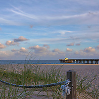 South Florida sunset photography of Pamplona Beach Fishing Pier and beach. This Florida fishing piers photography image is available as museum quality photography prints, canvas prints, acrylic prints or metal prints. Fine art prints may be framed and matted to the individual liking and decorating needs:<br /> <br /> https://juergen-roth.pixels.com/featured/florida-pamplona-beach-fishing-pier-juergen-roth.html<br /> <br /> All Pamplona Beach Fishing Pier Florida panorama photography photos are available for digital and print image licensing at www.RothGalleries.com. Please contact me direct with any questions or request.<br /> <br /> Good light and happy photo making!<br /> <br /> My best,<br /> <br /> Juergen<br /> Prints: http://www.rothgalleries.com<br /> Photo Blog: http://whereintheworldisjuergen.blogspot.com<br /> Twitter: @NatureFineArt<br /> Instagram: https://www.instagram.com/rothgalleries<br /> Facebook: https://www.facebook.com/naturefineart