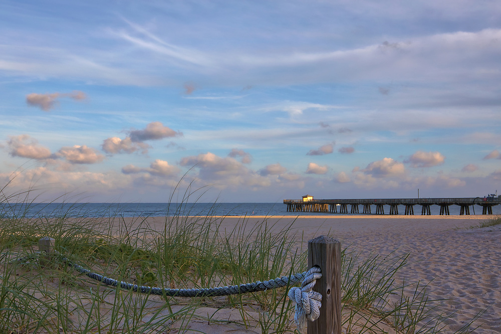 South Florida sunset photography of Pamplona Beach Fishing Pier and beach. This Florida fishing piers photography image is available as museum quality photography prints, canvas prints, acrylic prints or metal prints. Fine art prints may be framed and matted to the individual liking and decorating needs:<br />