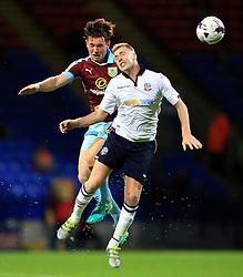 Dean Moxey of Bolton Wanderers wins a header - Mandatory by-line: Matt McNulty/JMP - 26/07/2016 - FOOTBALL - Macron Stadium - Bolton, England - Bolton Wanderers v Burnley - Pre-season friendly