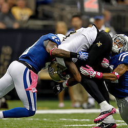 October 23, 2011; New Orleans, LA, USA; Indianapolis Colts cornerback Kevin Thomas (21) and safety Antoine Bethea (41) tackle New Orleans Saints wide receiver Marques Colston (12) during the third  quarter of a game at the Mercedes-Benz Superdome. The Saints defeated the Colts 62-7. Mandatory Credit: Derick E. Hingle-US PRESSWIRE / © Derick E. Hingle 2011