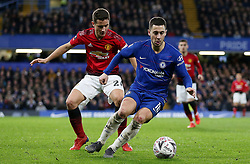 Manchester United's Nemanja Matic (left) and Chelsea's Eden Hazard battle for the ball during the FA Cup fifth round match at Stamford Bridge, London.