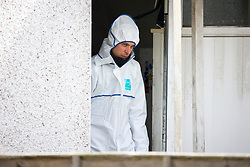 © Licensed to London News Pictures. 27/04/2017. Leeds UK. Picture shows police crime scene investigators at the scene of a house fire on Harehills lane in Leeds. A woman has been arrested after a man died following a house fire on Harehills Lane in Leeds early this morning. A man found at the scene was treated by firefighter and paramedics but was pronounced dead at the scene. A 28 year old woman has been arrested on suspicion of manslaughter & production of Cannabis after the remains of a cannabis growing set up were found at the property. Photo credit: Andrew McCaren/LNP