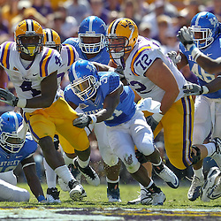 October 1, 2011; Baton Rouge, LA, USA;  LSU Tigers running back Alfred Blue (4) breaks a tackle by Kentucky Wildcats safety Mikie Benton (31) during the second quarter at Tiger Stadium.  Mandatory Credit: Derick E. Hingle-US PRESSWIRE / © Derick E. Hingle 2011