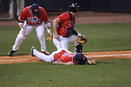 Ole Miss' Taylor Hightower (13), Ole Miss' Preston Overbey(1), and Ole Miss' Mike Mayers (28) field a bunt at Oxford-University Stadium in Oxford, Miss. on Wednesday, March 2, 2010.