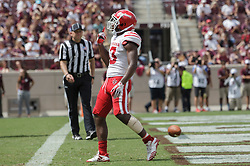 Louisiana-Lafayette wide receiver Ryheem Malone (13) reacts after scoring a touchdown during the second quarter of an NCAA college football game against Texas A&M Saturday, Sept. 16, 2017, in College Station, Texas. (AP Photo/Sam Craft)