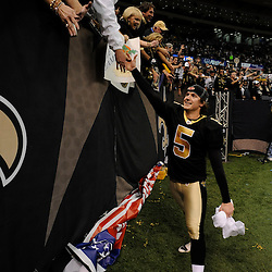 Jan 24, 2010; New Orleans, LA, USA; New Orleans Saints PK Garrett Hartley (5) celebrates with fans following a 31-28 overtime victory by the New Orleans Saints over the Minnesota Vikings in the 2010 NFC Championship game at the Louisiana Superdome. Mandatory Credit: Derick E. Hingle-US PRESSWIRE
