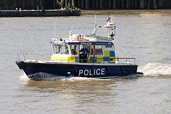 May 24, 2017 - London, London, UK - LONDON, UK.  A reguar marine police patrol boat follows officers from the Metropolitan Police, including some armed officers board RIBs (Rigid Inflatable Boat) this morning as they leave their base on the River Thames.  The Marine Police Unit will be carrying out training exercises on the River Thames today, as the Metropolitan Police Serrvice has confimed it has increased police numbers in the capital in response to the increased terrorist threat. (Credit Image: © Vickie Flores/London News Pictures via ZUMA Wire)