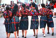 GUATEMALA, HIGHLAND MARKET Chichicastenango; girls in new shoes
