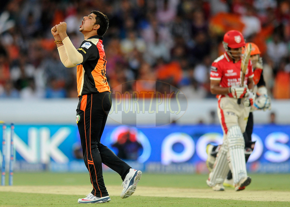 Karn Sharma of the Sunrisers Hyderabad celebrates the wicket of Wriddhiman Saha of the Kings X1 Punjab during match 39 of the Pepsi Indian Premier League Season 2014 between the Sunrisers Hyderabad and the Kings XI Punjab held at the Rajiv Gandhi Cricket Stadium, Hyderabad, India on the 14th May  2014<br /> <br /> Photo by Pal Pillai / IPL / SPORTZPICS<br /> <br /> <br /> <br /> Image use subject to terms and conditions which can be found here:  http://sportzpics.photoshelter.com/gallery/Pepsi-IPL-Image-terms-and-conditions/G00004VW1IVJ.gB0/C0000TScjhBM6ikg