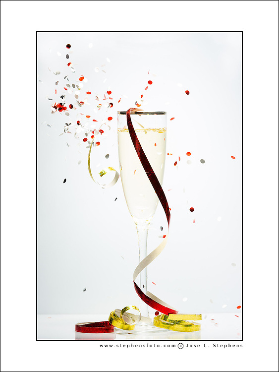 Celebration concept represented with confetti over a glass of Champagne