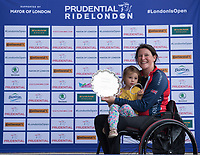 Jen Warren poses with her Womens Winner Plate after success in the Prudential RideLondon Handcycle Grand Prix. <br /> <br /> Prudential RideLondon 28/07/2017<br /> <br /> Photo: Tom Lovelock/Silverhub for Prudential RideLondon<br /> <br /> Prudential RideLondon is the world&rsquo;s greatest festival of cycling, involving 100,000+ cyclists &ndash; from Olympic champions to a free family fun ride - riding in events over closed roads in London and Surrey over the weekend of 28th to 30th July 2017. <br /> <br /> See www.PrudentialRideLondon.co.uk for more.<br /> <br /> For further information: media@londonmarathonevents.co.uk
