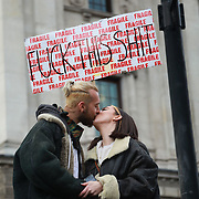 Put It To The People march for a Peoples Vote on 23rd March 2019 in London, United Kingdom. With less than one week until the UK is supposed to be leaving the European Union, the final result still hangs in the balance. An estimated one million protesters gathered to make political leaders take notice and to give the British public a vote on the final Brexit deal. A young couple kiss in Whitehall.
