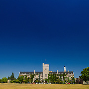 Johnston Hall at the University of Guelph.  Johnston green below, and blue sky above.  Photo by Andrew Goodwin