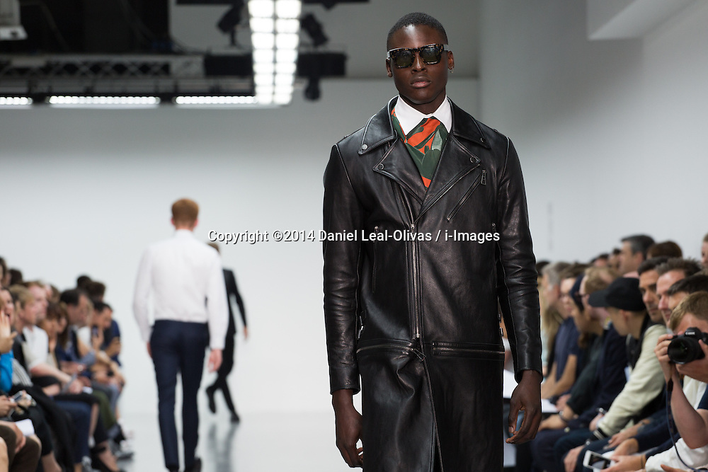 Image ©Licensed to i-Images Picture Agency. 17/06/2014. London, United Kingdom. London Collections: Men - Last Day. A model walks through the catwalk displaying a collection by A. Sauvage during the third and last day of the Spring/Summer 2015 at Victoria House. Picture by Daniel Leal-Olivas / i-Images