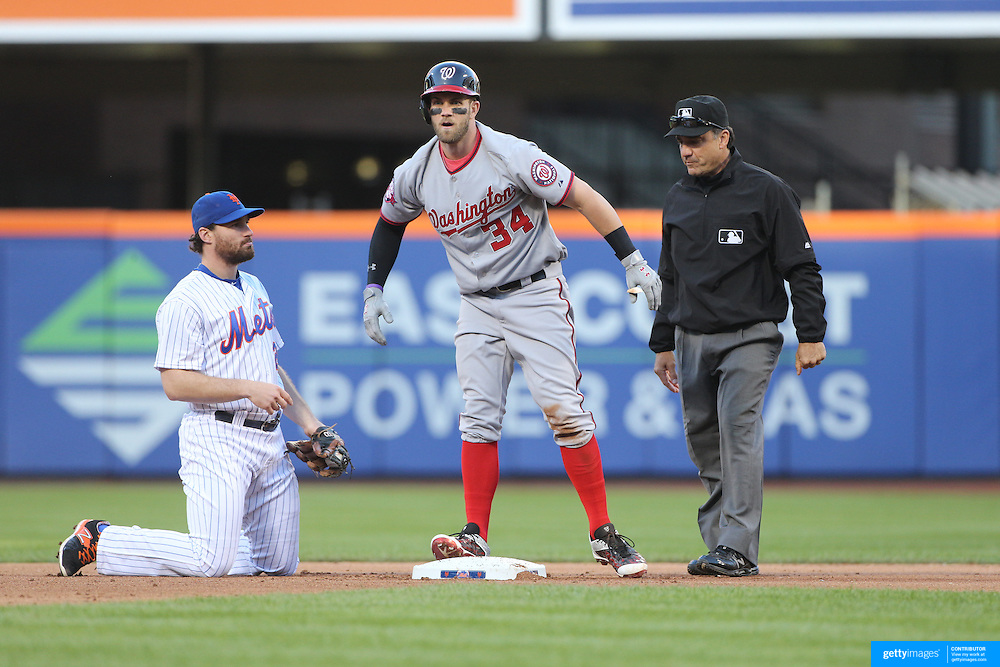 Bryce Harper, Washington Nationals, beats the tag attempt of Daniel Murphy, New York Mets, after hitting a double in the ninth inning during the New York Mets Vs Washington Nationals MLB regular season baseball game at Citi Field, Queens, New York. USA. 4th October 2015. Photo Tim Clayton