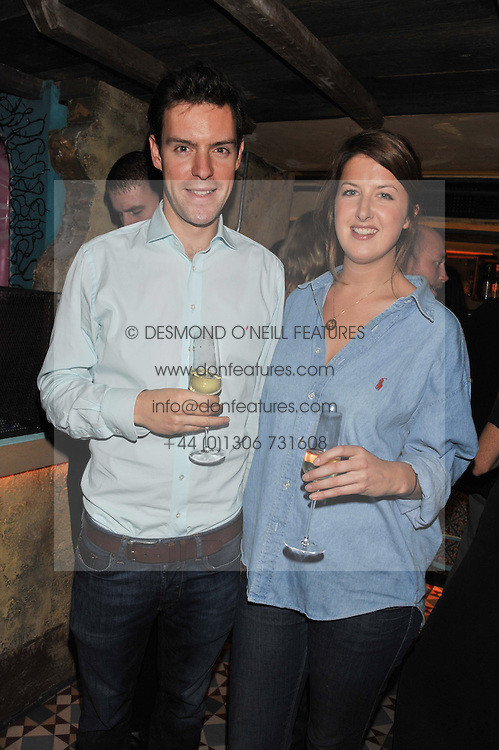 CATH BECKETT and HARRY COLLINS at the launch party for the new nightclub Tonteria, 7-12 Sloane Square, London on 25th October 2012.