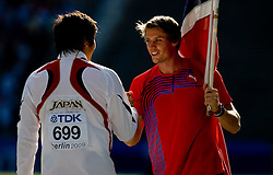 Third placed Yukifumi Murakami of Japan and Andreas Thorkildsen of Norway celebrates after winning the men's Javelin Throw Final during day nine of the 12th IAAF World Athletics Championships at the Olympic Stadium on August 23, 2009 in Berlin, Germany. (Photo by Vid Ponikvar / Sportida)