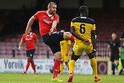 Jon Parkin of York City (19) has a shot during the Vanarama National League match between York City and Kidderminster Harriers at Bootham Crescent, York, England on 15 September 2018.