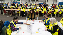 Edinburgh, Scotland, UK. 12th December 2019. Postal votes being counted at Parliamentary General Election Count at the Royal Highland Centre in Edinburgh. Five constituencies are being counted in Edinburgh, Edinburgh West, Edinburgh South West, Edinburgh North & Leith, Edinburgh South and Edinburgh East. Iain Masterton/Alamy Live News