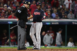 October 11, 2017 - Cleveland, OH, USA - The Cleveland Indians' Edwin Encarnacion, right, argues a called third strike with umpire Jeff Nelson during the fourth inning against the New York Yankees during Game 5 of the American League Division Series, Wenesday, Oct. 11, 2017, at Progressive Field in Cleveland. (Credit Image: © Phil Masturzo/TNS via ZUMA Wire)