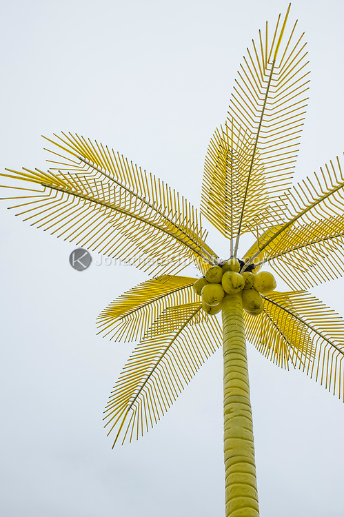 Low angle view of a fake yellow palm tree at the airport in Guilin, China.