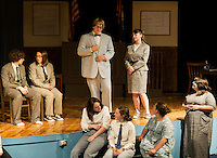 """Matthew Harrison Brady (Taylor Gagne) and E.K. Hornbeck (Ashley Neylon) surrounded by members of the cast of """"Inherit The Wind"""" during dress rehearsal Wednesday afternoon at Laconia High School.  (Karen Bobotas/for the Laconia Daily Sun)"""