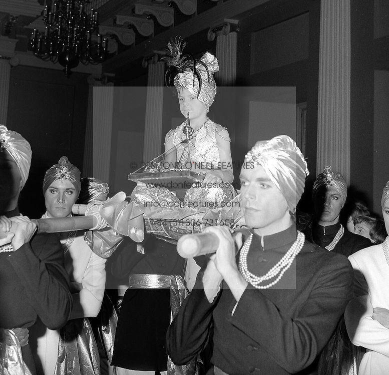 """The Graff Gala - a supper party and jewellery presentation by Laurence Graff to celebrate the 9th birthday of KIDS - a national charity for handicapped children took place at the Banqueting House, Whitehall, London on 3rd December 1979.  The highlight of the evening was the display of the famous """"Idol's Eye"""" - the largest known natural blue diamond in The World.<br /> Picture shows:- A Small boy carrying the """"Idol's Eye"""" into the Banqueting Hall."""