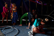 Performers in the Carson & Barnes Circus, from left, July Jacquelini Coronel, Ana Claudia Dos Santos, Kevin Zandrac and Carolina Morella, stretch and prepare before an afternoon show in the suburbs of Dallas, on Thursday afternoon, March 26, 2009.