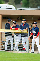 KELOWNA, BC - JULY 16: Kelowna Falcons' coaches stand in the dugout against the the Wenatchee Applesox at Elks Stadium on July 16, 2019 in Kelowna, Canada. (Photo by Marissa Baecker/Shoot the Breeze)