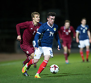 10th November 2017, McDiarmid Park, Perth, Scotland, UEFA Under-21 European Championships Qualifier, Scotland versus Latvia; Scotland's Stephen Mallan races away from Latvia's Vladislavs Sorokins