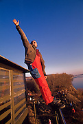 December 10, 1989. Bratislava/Devin, Czechoslovakia. A young Slovak enjoys the view over the Danube from a watchtower at the now defunct Iron Curtain at the border to Austria. (Photo Heimo Aga)