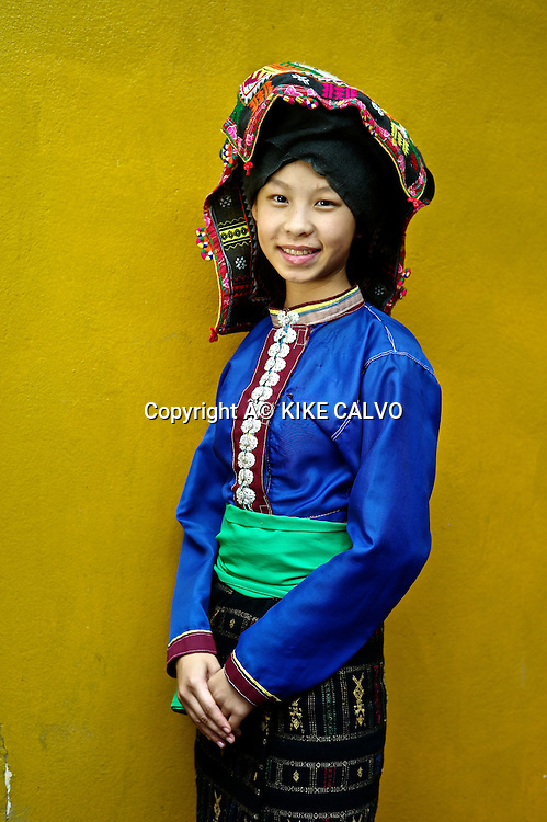 Teen girl wearing Tai Dam traditional dress in Laos. Its used in Luang Prabang province.